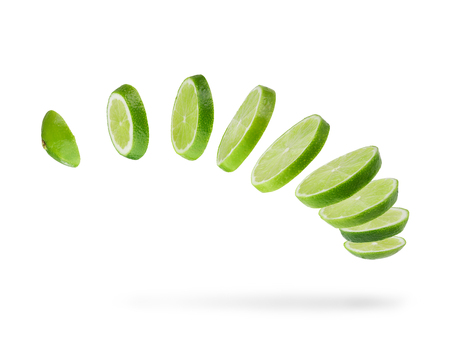 sliced and falling  fresh lime  isolated on white background