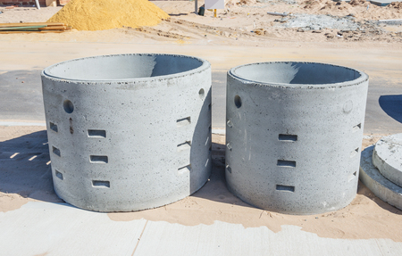 wells: Two concrete soakwells on the construction site before installation Stock Photo