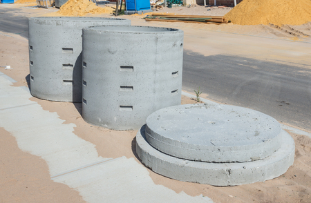 wells: Two concrete soakwells with covers on the construction site before installation