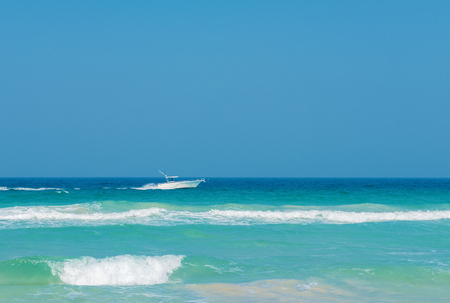 motor boat  at high speed on a sunny day,vacation,resting and travel concept
