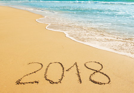 Digits 2018 on the sand seashore - concept of New Year and Xmas Stock fotó