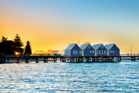 Beautiful sunset at wooden Busselton jetty in Western Australia - longest timber piled jetty in the southern hemisphere, with  tourists silhouettes