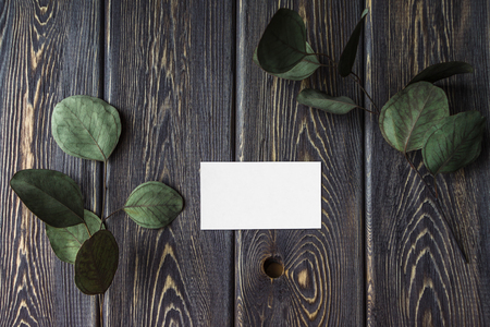 Creative layout made of leaves on old wooden table with business creative layout made of leaves on old wooden table with business card flat lay reheart Choice Image