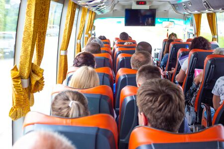 Tourists ride a bus on a sightseeing tour Banco de Imagens