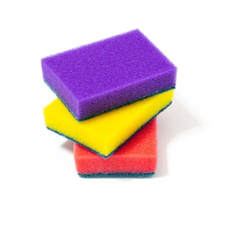 multi-colored sponges for washing dishes on a white background Banco de Imagens