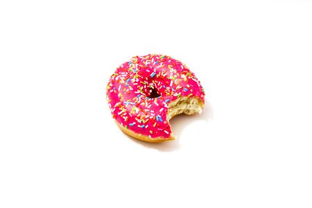 bitten pink donut on a white background, delicious sweet snack