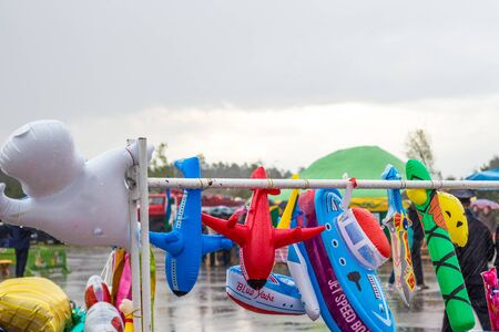 inflatable bathing toys get wet in the rain, the end of the beach season,