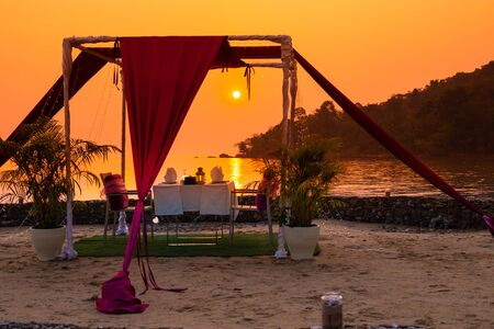 gazebo for relaxing on the beach at sunset, a romantic dinner in the privacy