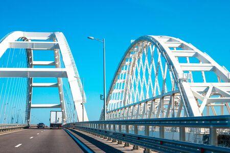 White arches of the Crimean bridge in Russia, transport rides, near the railway bridge