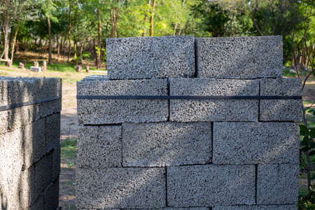 blocks of aerated concrete are neatly stacked in pallets. Construction and repair of a country house.