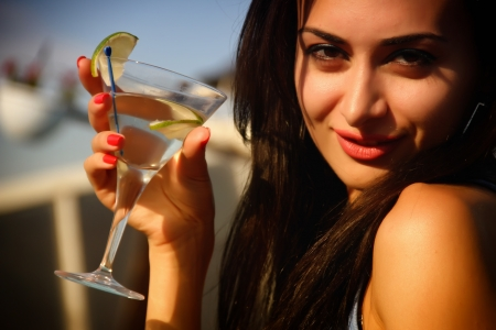 Attractive young girl drinking martini Stock Photo