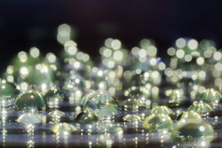 Water Drops on a Reflective Surface Stock Photo