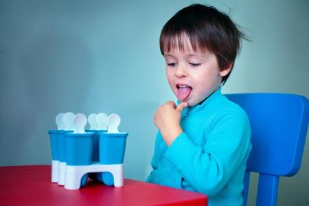 Portrait of a little boy tasting homemade ice cream