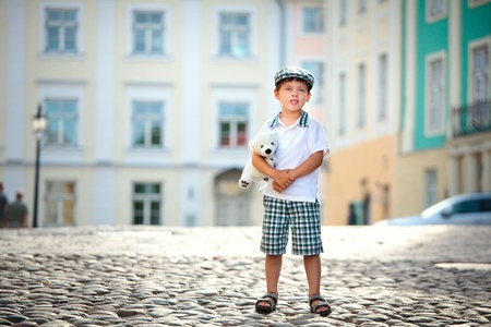 Portrait of a little boy outdoors in city  Stock Photo