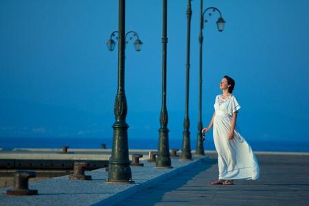 Beautiful woman on a pier photo