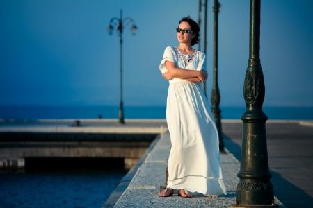 maxi dress: Beautiful woman on a pier