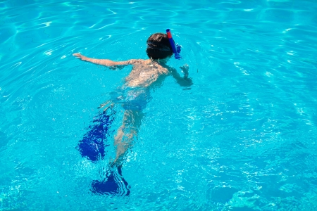 pool diving: Little boy diving under water