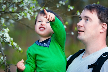 Father and his little son in spring park Stock Photo - 13688988