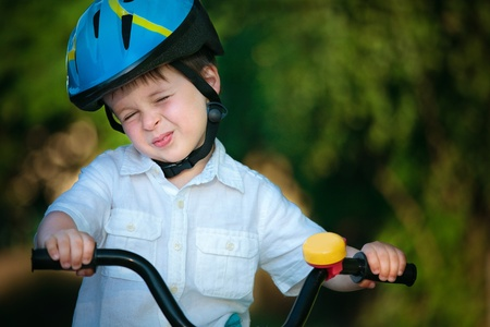 Portrait of a cute little boy in a bicycle  Stock Photo