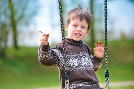 Small child on swing photo