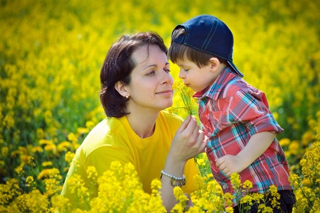 Mother and little child on yellow meadow Stock Photo - 13689108