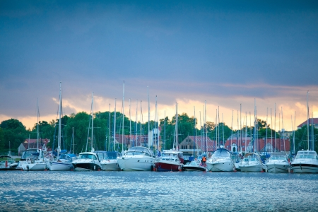 Boats in the harbor of Mikolajki, Poland at sunset