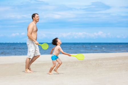 Father and son playing together on the beach Stock Photo - 14127808