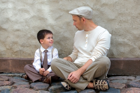 Young father and son outdoors in city on beautiful summer day Stock Photo - 14980597