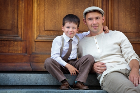 Young father and son outdoors in city on beautiful summer day  Stock Photo
