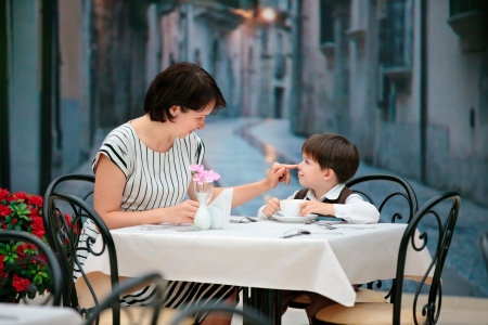 Mother and son having lunch together at the mall Фото со стока