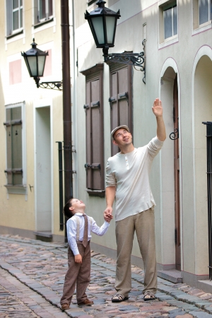 Father and son walking outdoors in city on beautiful summer day Stock Photo - 16037197