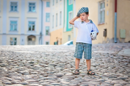 street kid: Portrait of a little 3 years old boy outdoors in city on summer day