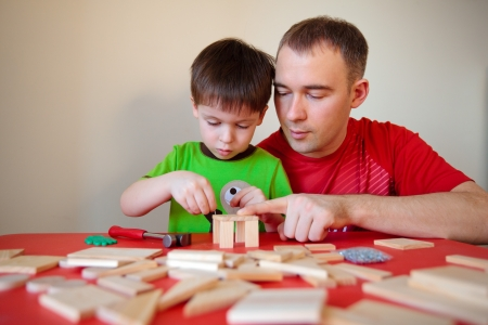 Happy family  Father and son working at home Stock Photo