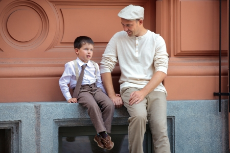 suspenders: Happy father and little son having fun in city
