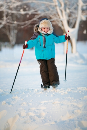 Cute little boy having fun during skiing on cross photo