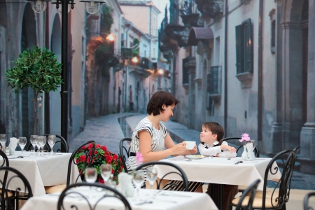 Mother and son sitting in cafe