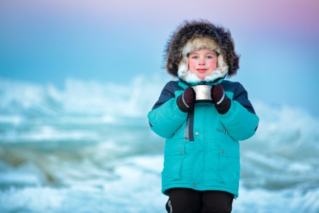 Cute five years old boy drinking hot tea in winter Stock Photo