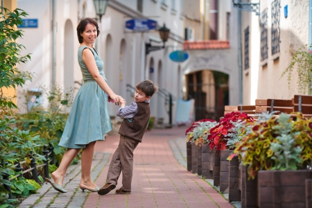 Young mother and her son walking outdoors in city Stock Photo - 18263281
