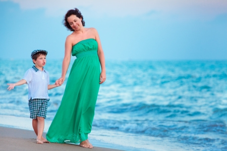 Mother and her little son enjoying beach Stock Photo