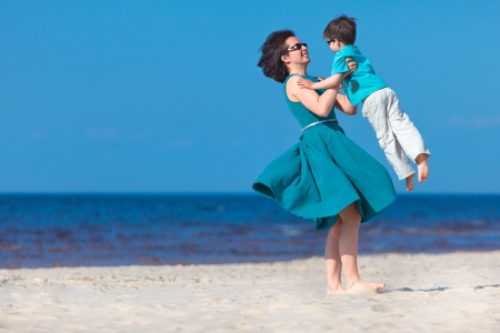Mother and her little son enjoying beach Stock Photo - 18263243