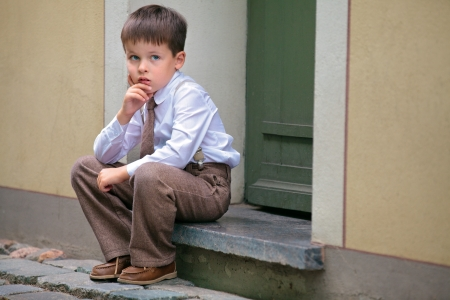 Portrait of a little boy having relax on the porch Stock Photo - 20620363