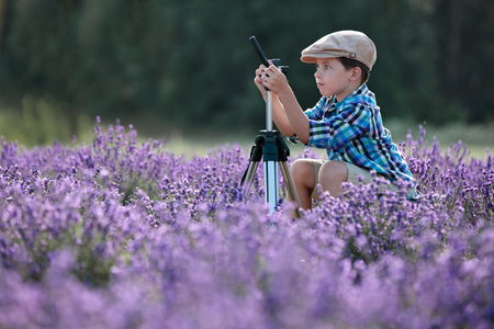 Cute little boy prepare for photography in lavender field