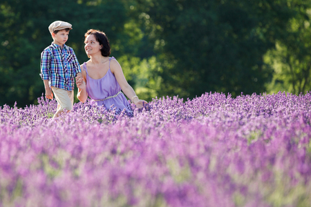 Young woman and her little son in lavender field Stock Photo