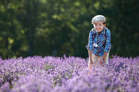 Cute little boy in lavender field 版權商用圖片