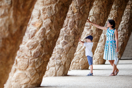 Young mother and her son walking Park Guell, Barcelona Imagens