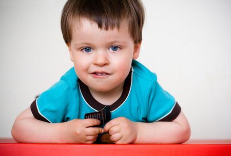 Portrait of a cute and pensive little boy
