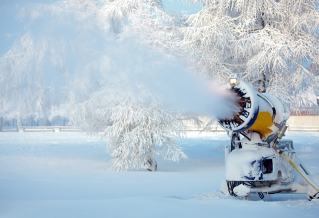 Working snow cannon on beautiful winter day