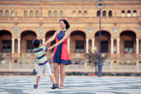 Young mother and her son playing outdoors, Sevilla, Spain