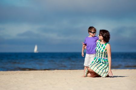 Young mother and her cute little son on summer vacation Foto de archivo