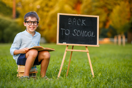 Cute little schoolboy feeling excited about going back to school Stock Photo